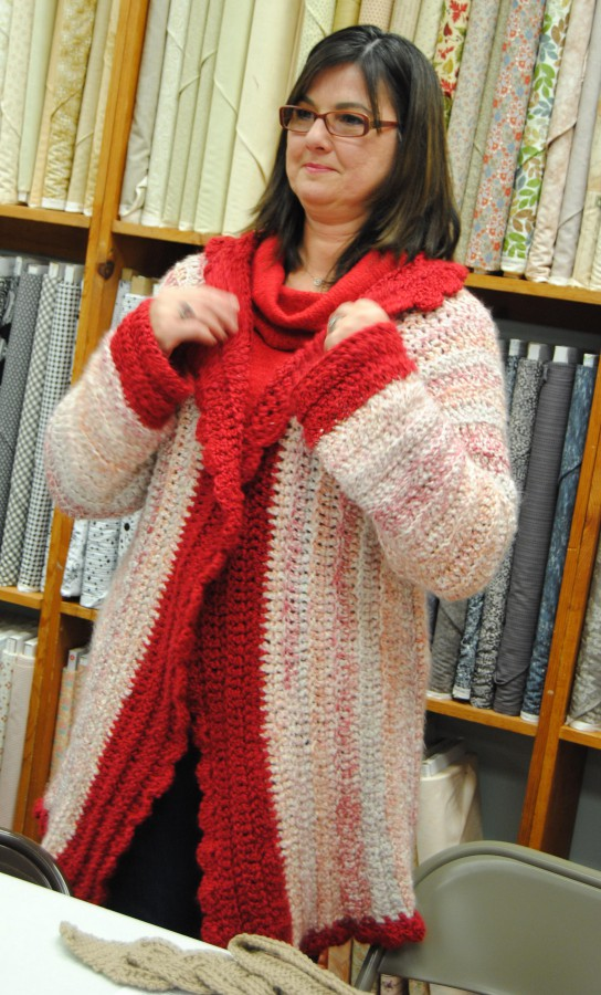 Mara looks lovely in her fluffy crocheted sweater coat.